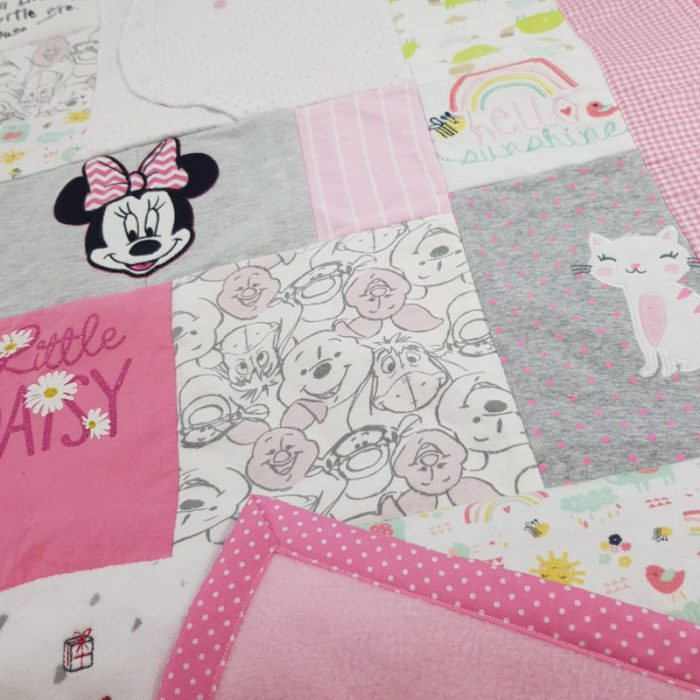 memory blanket made out of girls baby clothes