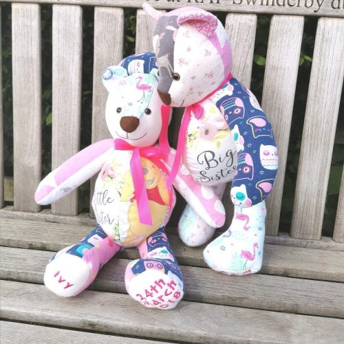 Two memory bears made out of girls baby clothing