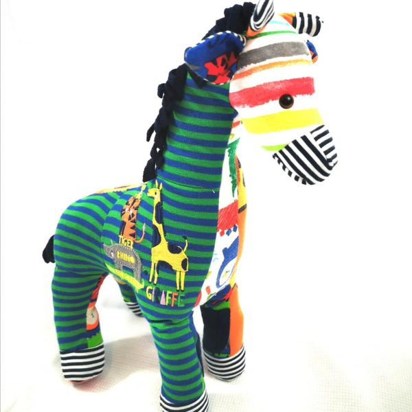 keepsake giraffe made out of your baby's bright babygros