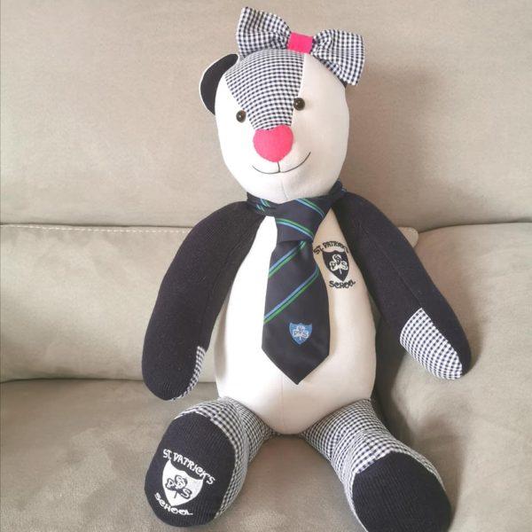 A bigger than average memory bear using school uniform