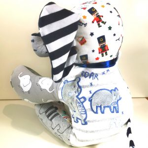 The back view of a keepsake elephant made out of baby clothing