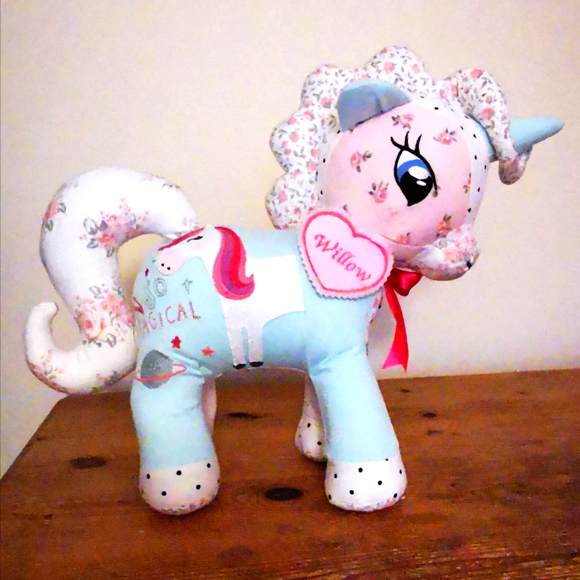 pink unicorn made out of babygros